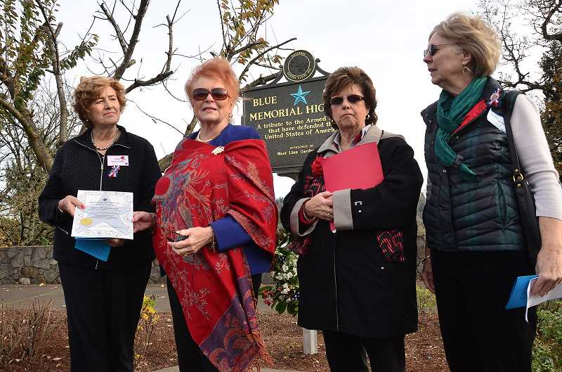 by: VERN UYETAKE - West Linn Garden Club President Jane Sercombe, left, accepts an award from National Garden Club President Linda Nelson, standing, who is next to the State Garden Club President Peggy Olin, along with Co-district Director for Clackamas County Darby Walker.