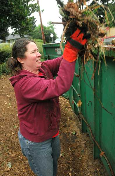 by: TIDINGS FILE PHOTO: VERN UYETAKE - Neighbors Helping Neighbors is split into two events this year: a leaf cleanup Dec. 14 and a regular yard cleanup in April.