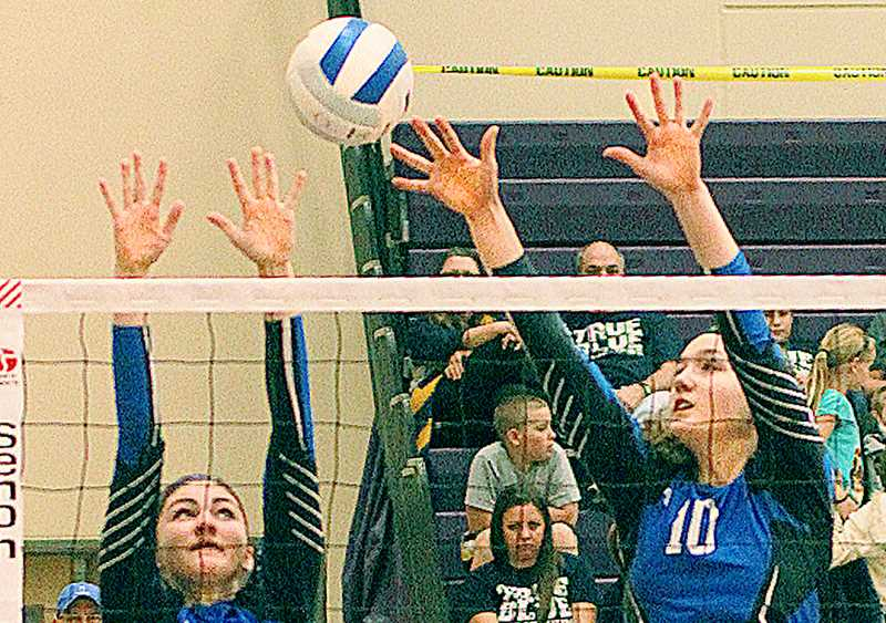 by: BILLY GATES - So close - Madison Caldwell (left) and Delaney Sump rise for a block against Imbler in the first round of the tournament Friday.