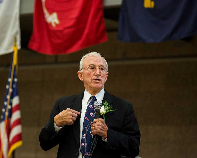 by: NEWS-TIMES PHOTO: CHASE ALLGOOD - Retired Air Force Brigadier General James Sehorn riveted students, parents and veterans with an account of his experience as a prisoner of war in Vietnam during an assembly Friday at Forest Grove High School.