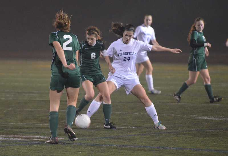 by: JEFF GOODMAN - Ali Bourque (24) battles for possession during the Class 5A state semifinals Nov. 12 at Randall Stadium. The Wilsonville girls soccer team finished its season with a loss to Portland-Wilson.