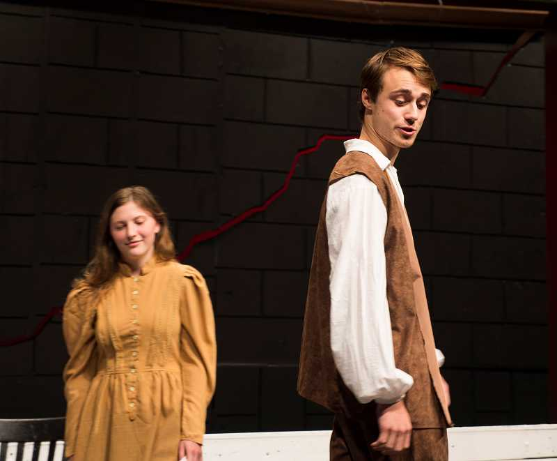 by: NEWS-TIMES PHOTO: CHASE ALLGOOD - Tess ODay (as Abigail Adams) and Luke Boyer (as John Proctor) lead a cast of 20 in Forest Grove High Schools fall play, The Crucible.
