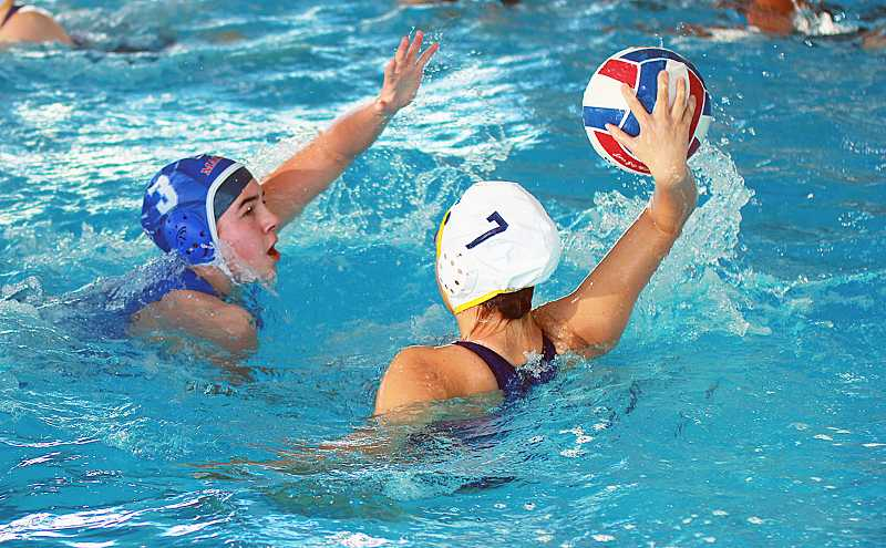 by: PIONEER FILE PHOTO - Madras Sophie Gemelas tries to go for the ball during a water polo match earlier in the fall at the Madras Aquatic Center. Gemelas was one of the top goal scorers in the entire state in girls high school water polo this season. Gemelas helped guide the Buffs to a state playoff appearance against Ashland.