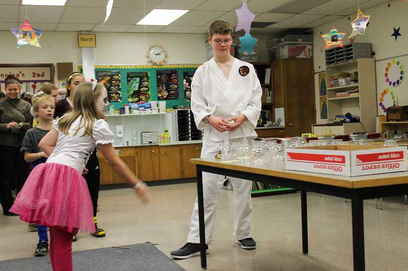 A ping-pong ball game attracted Lauren Kramer, 9, a fourth-grader. The event had been postponed after the Oct. 20 deaths of Dilley student Anna Dieter-Eckerdt and her sister, Abigail Robinson, a student at Tom McCall Upper Elementary School.