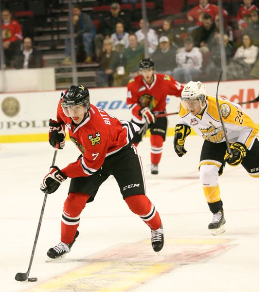 by: COURTESY OF PORTLAND WINTERHAWKS - Winterhawks forward Paul Bittner moves the puck in a recent game against the Brandon Wheat Kings.