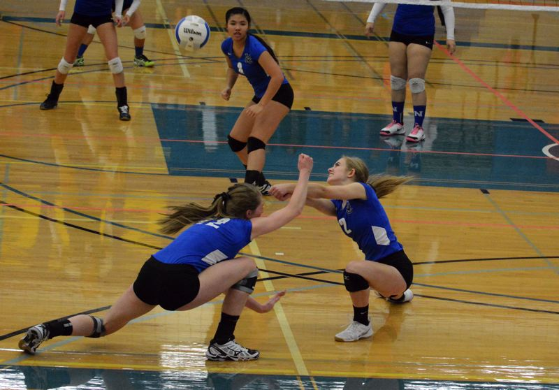 by: TIMES PHOTO: MATT SINGLEDECKER - Valley Catholic setter Emily Groh digs out a backline Nyssa spike.