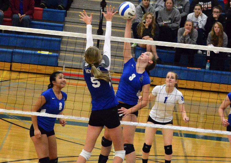 by: TIMES PHOTO: MATT SINGLEDECKER - Valley Catholic senior middle blocker Madeline Henningsen rises for a kill attempt against Nyssa.