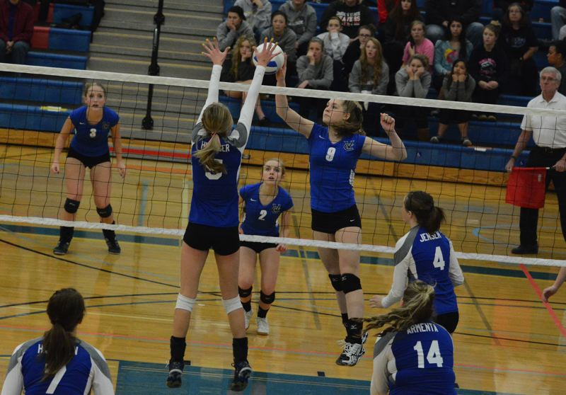 by: TIMES PHOTO: MATT SINGLEDECKER - Junior middle blocker Rebecca Fischer goes up for a tip shot in the first set of the Valiants four-set 3A quarterfinal win over Nyssa.