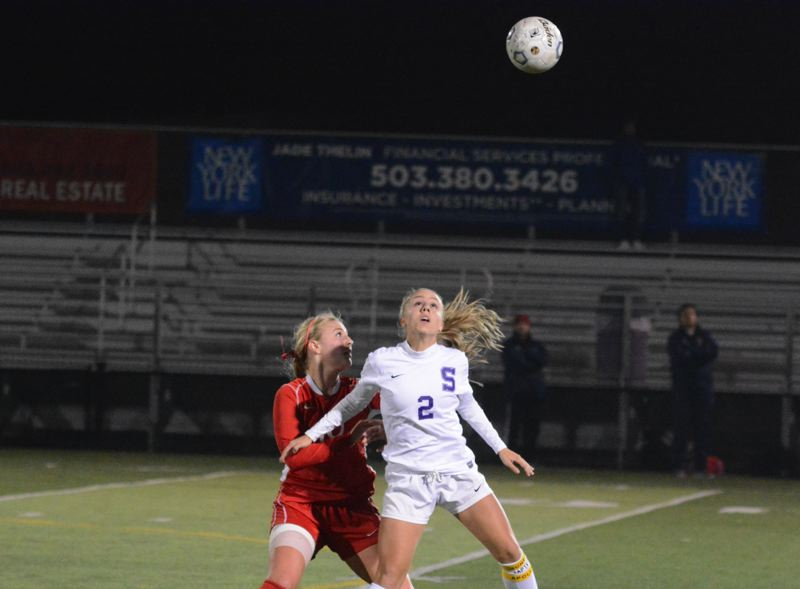 by: TIMES PHOTO: MATT SINGLEDECKER - Sunset senior Grace Mettler heads a ball in the air during the Apollos 1-0 extra time win over Westview.