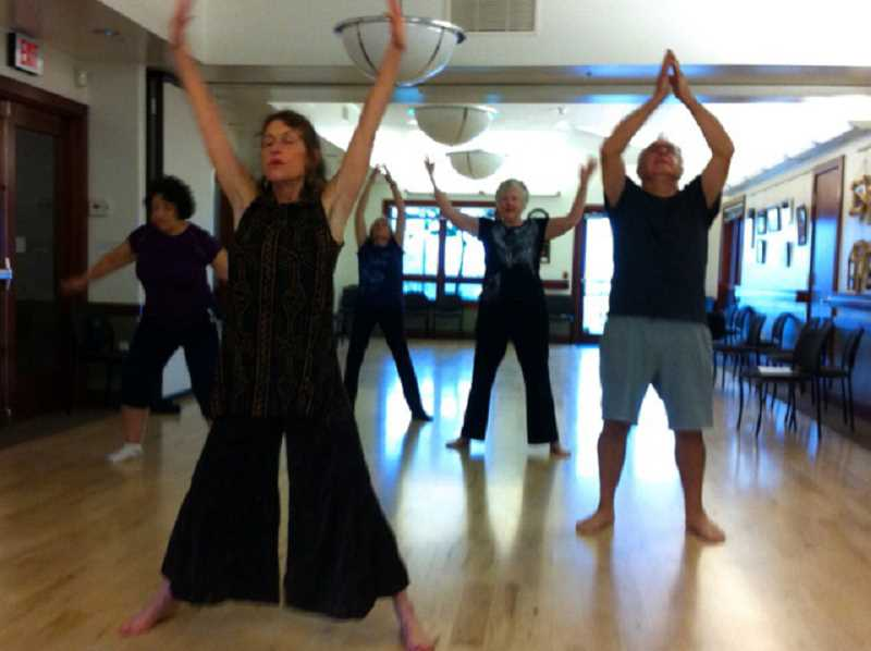 by: SUBMITTED PHOTO - Nia instructor Mary Milner leads a class through a Nia workout. The class is held twice a week at the West Linn Adult Community Center.