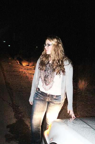 by: HOLLY M. GILL - Amanda Barrett, 16,  stands in the location where the vehicle she was driving was hit by a deer on Oct. 25. Barrett and her passenger were not hurt.