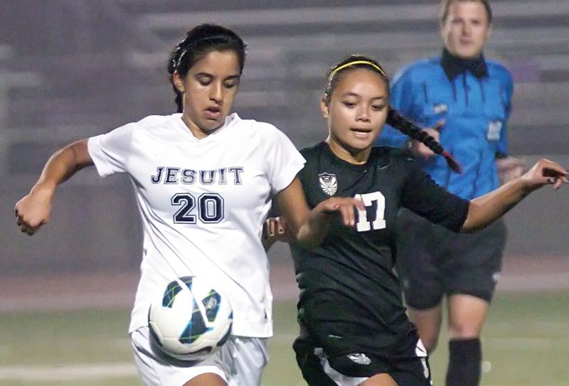 by: TIMES PHOTO: DAN BROOD - Jesuit defender Mika Chesnutt controls a ball against Tualatin on Tuesday.