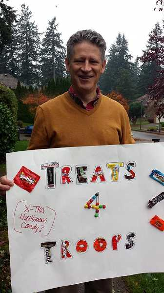 by: SUBMITTED PHOTO - Daniel Payne, of Tualatin, was one of a handful of people who collected left-over Halloween candy for Mission Mahalo, a Sherwood organization which sends care packages of goodies to troops serving overseas