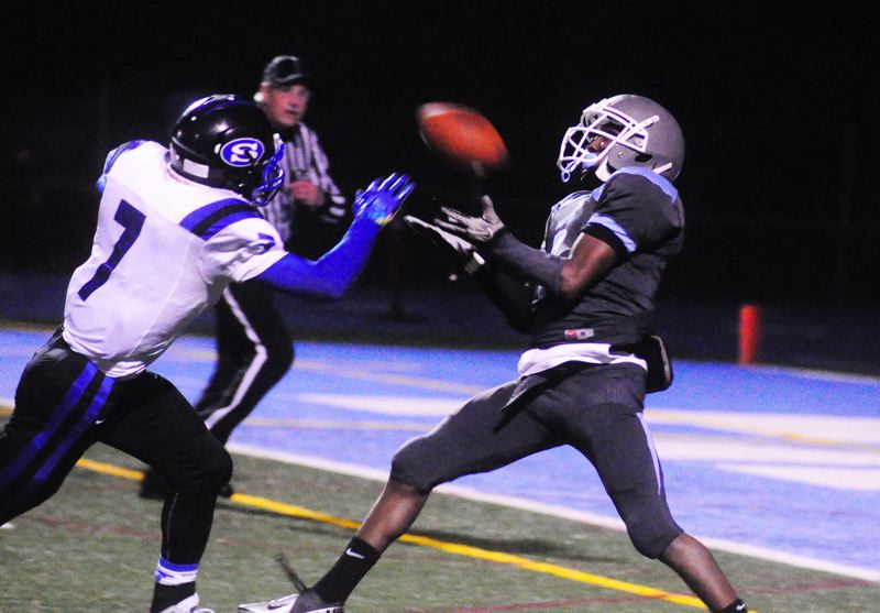 by: MATTHEW SHERMAN - Vontrell Mills hauls in a 36-yard touchdown pass in the first half of last week's first-round playoff victory over South Medford.