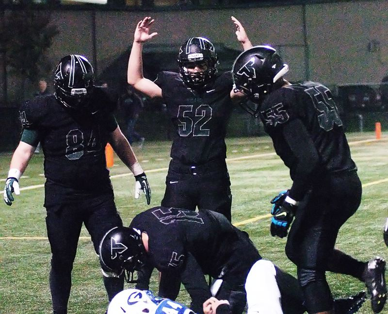 by: DAN BROOD - TIGER TD -- Tigard senior center Nathan Wick (52), next to teammates Jake Biglow (left) and Byron Hammick Jr., puts is arms in the air following a Landon Floyd touchdown run.