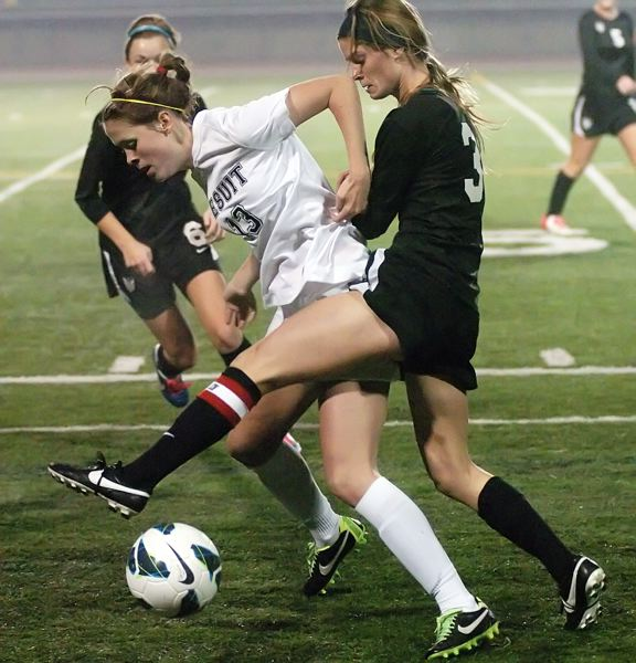 by: DAN BROOD - TIMBERWOLF TOUGH -- Tualatin senior Jill Farley (right) looks to get the ball away from Jesuit senior Dani Brown.
