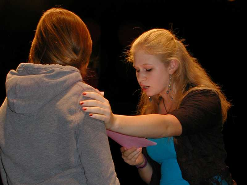 by: RON HALVORSON - Anna Rosenau practices lines with another student during the visit from the Oregon Shakespeare Festival actors.