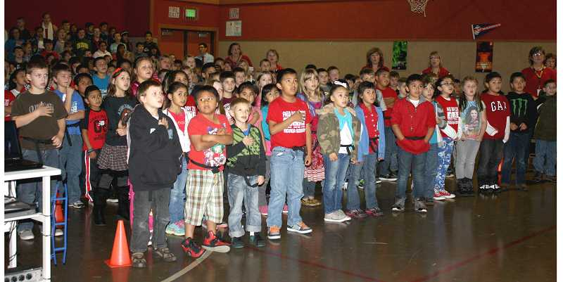 by: PEGGY SAVAGE - The young students sang patriotic songs to honor the veterans at the Molalla Elementary School celebration
