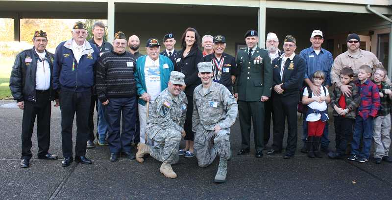by: PEGGY SAVAGE - Some of the veterans gathered for a photo following the event