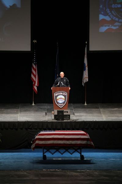 by: PAMPLIN MEDIA GROUP: JONATHAN HOUSE - Oregon City Police Chief James Band told the memorial service audience about the work that Officer Robert Libke did for the community.