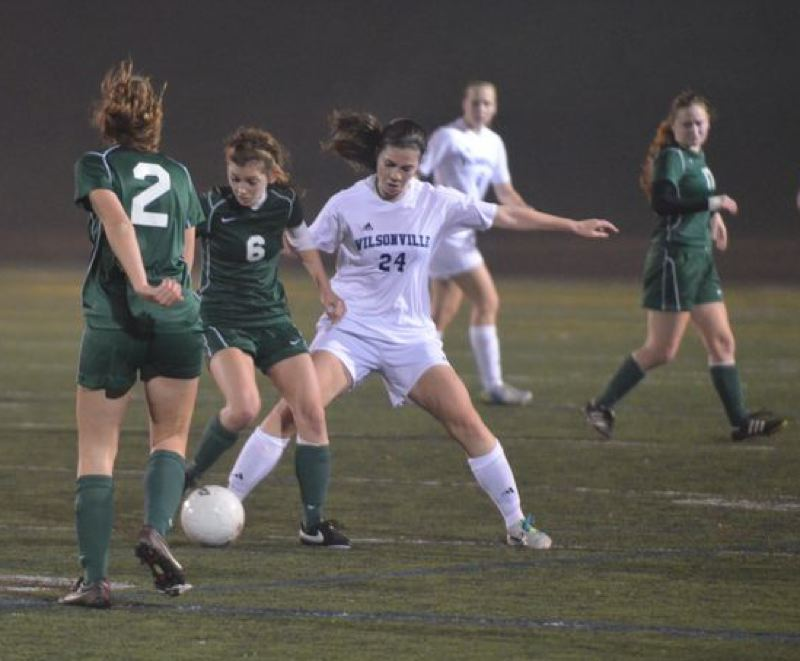 by: PAMPLIN MEDIA GROUP: JEFF GOODMAN - Wilson players Bethan Harper (left) and Dana Nathanson converge on Wilsonville's Ali Bourque in Tuesday's Class 5A semifinal, won by Wilson 1-0 at Wilsonville.