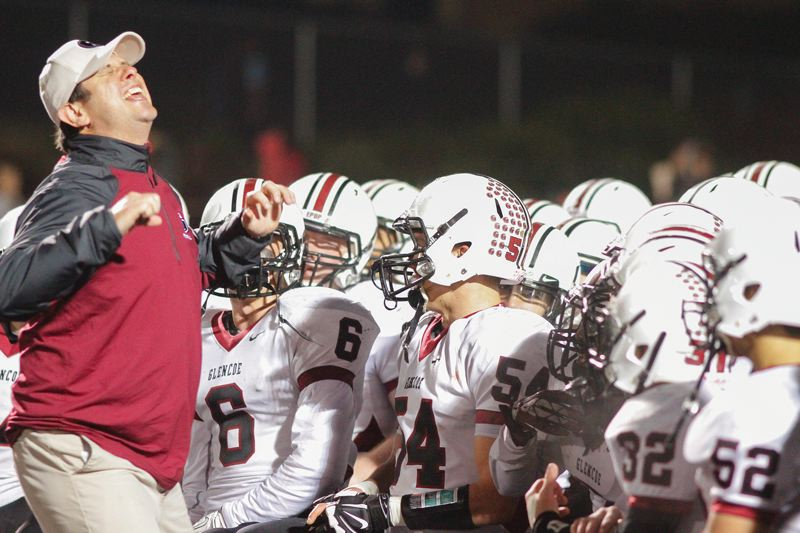 by: HILLSBORO TRIBUNE PHOTO: AMANDA MILES - Glencoe football coach Steve Jones gives his players a passionate postgame speech after the Crimson Tide upset 11th-ranked West Salem 49-34 in the first round of the Class 6A state playoffs last Friday night.