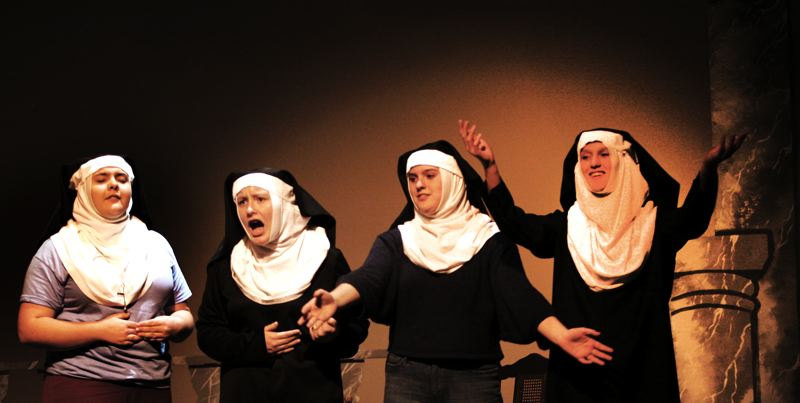 by: OUTLOOK PHOTO: JIM CLARK - The nuns of the abby try to answer the question 'How do you solve a problem like Maria?' in Corbett Children's Theater's production of 'The Sound of Music.' From left, Jordan Ziese as Mother Abbess, Emma Stewart as Sister Berthe, Maddie Carmen as Sister Sophia and Madison Dody as Sister Margaretta.