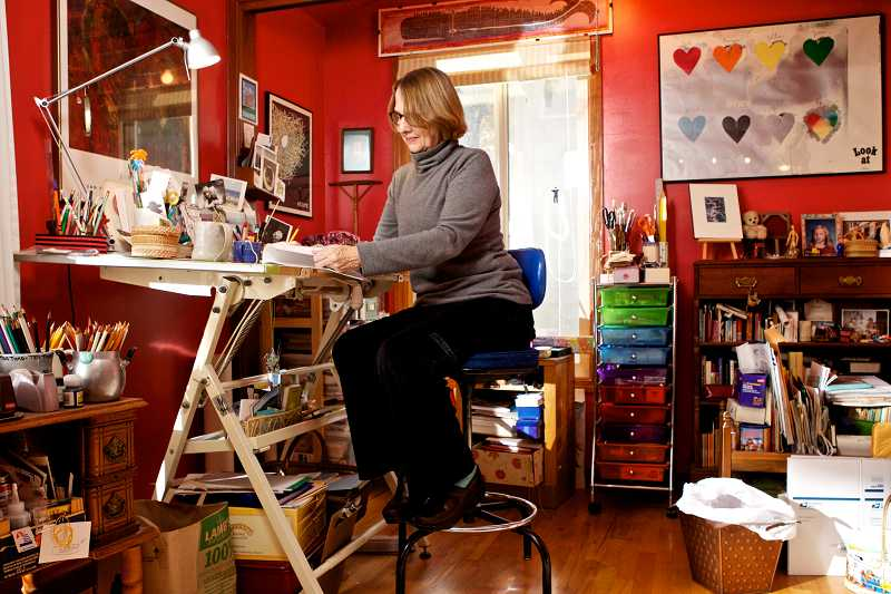 by: TIMES PHOTO: JAIME VALDEZ - Children's book author Susan Blackaby turns some pages in the workshop of her Raleigh Hills home.