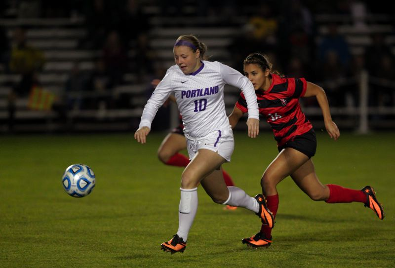 by: COURTESY OF UNIVERSITY OF PORTLAND - Freshman forward Danica Evans, who scored the winning goal Saturday night, chases down a ball against Seattle for the Portland Pilots.