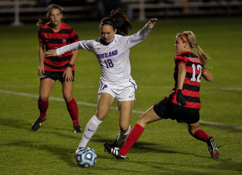 by: COURTESY OF UNIVERSITY OF PORTLAND - Noelle La Prevotte, UP frosh forward, slices through Seattle University defenders during the Pilots' 2-0 first-round NCAA playoff victory at Merlo Field.