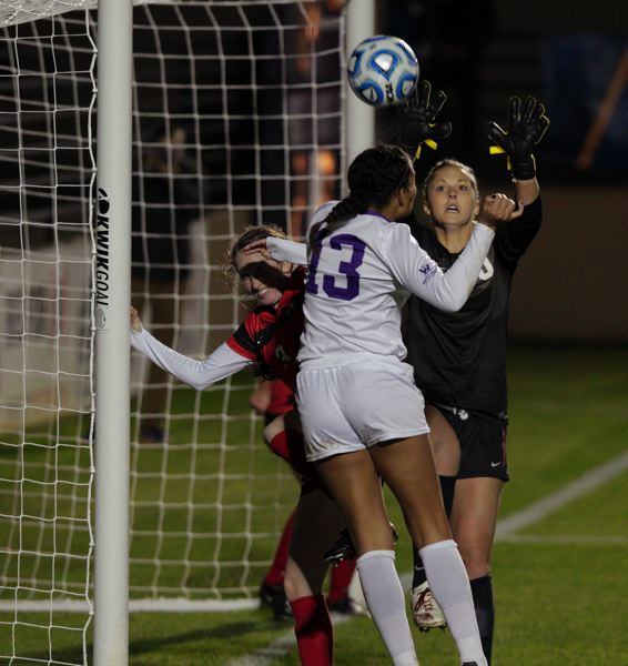 by: COURTESY OF UNIVERSITY OF PORTLAND - Portland's Rebekah Kurle (13) heads a corner kick over the crossbar in the first half.