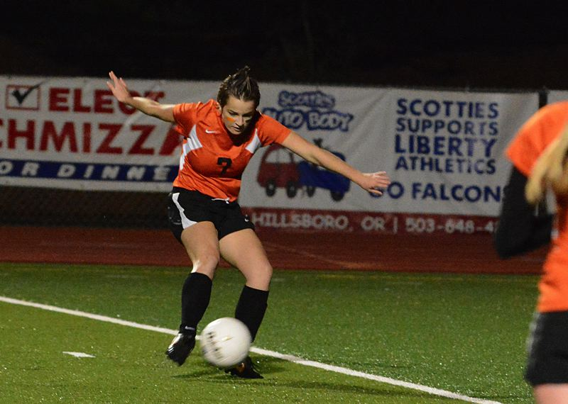 by: JOHN WILLIAM HOWARD - Sophomore Kim Carpenter takes a shot in the second half of the Indians' title match against La Grande. Carpenter sent the ball into the back of the net, giving Scappoose the lead for good.