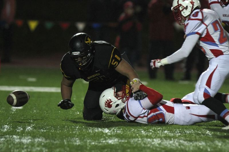 Roosevelt's Semise Kofe causes a fumble after a bruising hit on Ashland's Ryan Robitz.