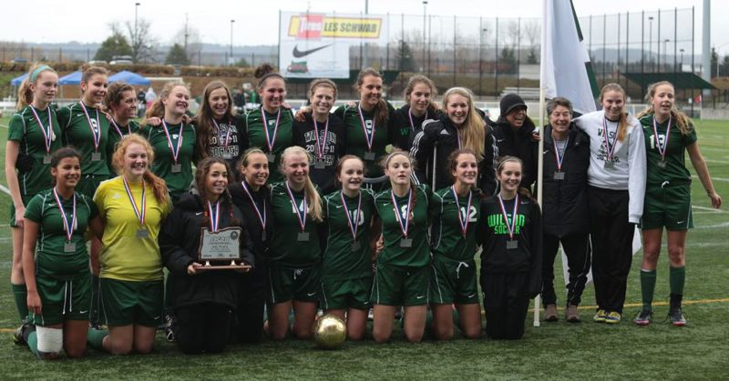by: TRIBUNE PHOTO: JONATHAN HOUSE - Wilson High's girls soccer team shows off its second-place trophy after the Class 5A championship match Saturday at Hillsboro Stadium.