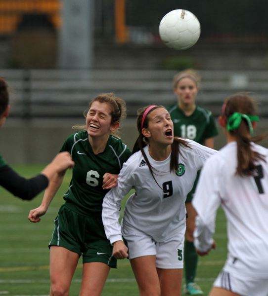 Wilson's Dana Nathanson (left) goes for a header with Summit's Christine Edwards.