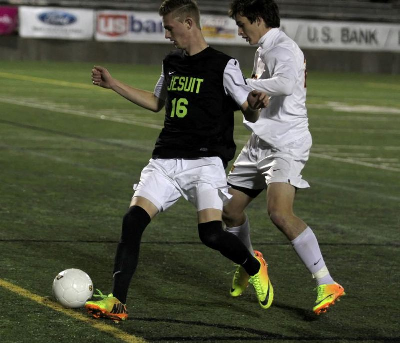 Jesuit's Christopher Chertude looks to keep possession.