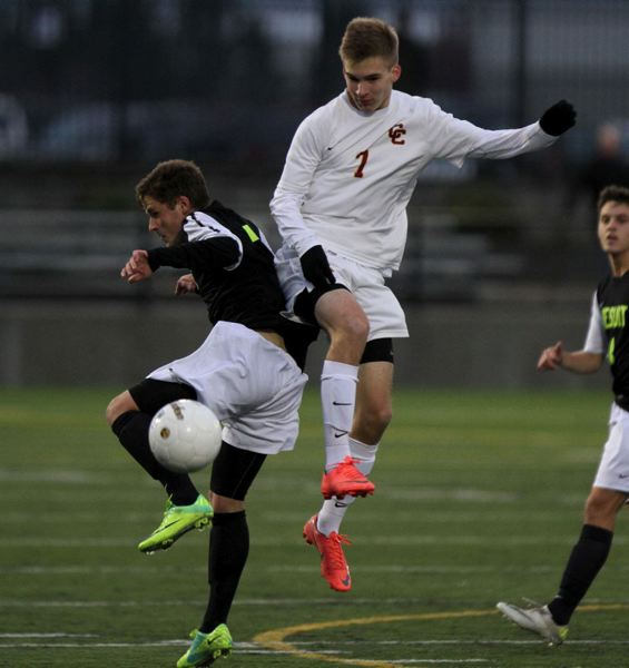 Jesuit's Tyler Street (left) and Central Catholic's Nick McAllister battle for the ball.