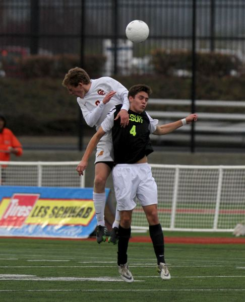 Joe Sorenson (left) of Central Catholic tries to outduel Jesuit's Spencer Scott for a ball in the air.
