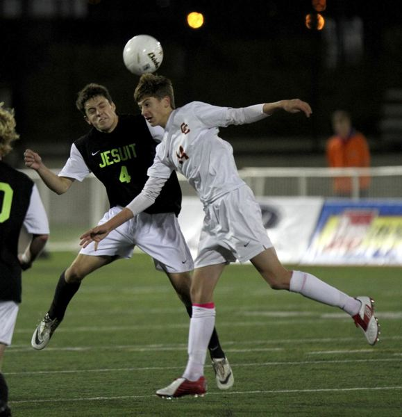Brennan Weber (right) of Central Catholic and Spencer Scott of Jesuit contest for a header.