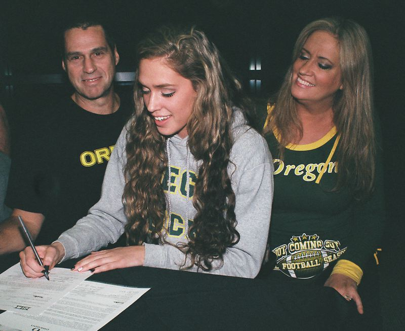 by: JOHN DENNY - Proud parents Brett and Dalene Agost were on hand last week when their daughter Taylor signed a National Letter of Intent, accepting a full-ride athletic scholarship to the University of Oregon.