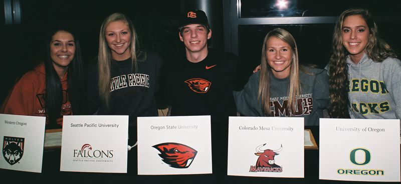 by: JOHN DENNY - Clackamas High School seniors (from left) Sydney Azorr, Erica Pagano, Elliott Cary, Kaitlyn Reiner and Taylor Agost signed National Letters of Intent before friends and family during Nov. 13 signing ceremonies in the high schools media center.