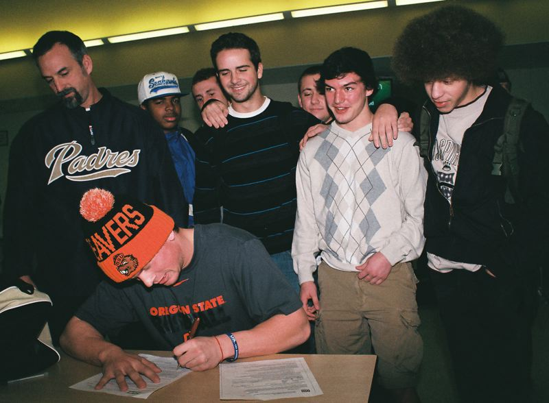 by: JOHN DENNY - Putnam coach Jason Stanley (left) and Trace Loehrs classmates (from left) Delaine Bohahan, Josh Bancroft, Joey Cardinal, Nick Edwards, Eamon Gallagher and Chris Kalonji were on hand last week when Loehr accepted a full-ride scholarship to play baseball at Oregon State University.