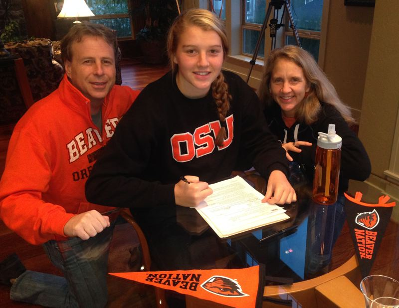 by: SUBMITTED - Portland Waldorf senior Ellie Lesch, pictured with parents Phil and Donna Lesch, has accepted a scholarship to compete for Oregon State University in rowing.