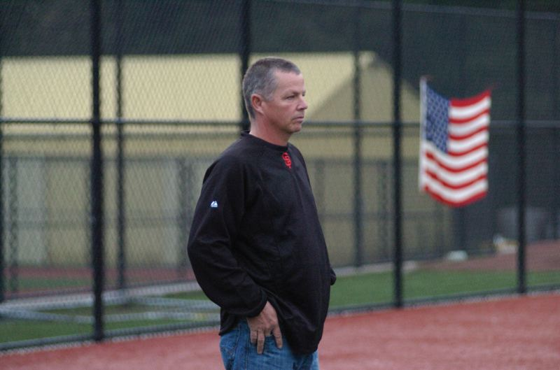 by: SANDY POST: PARKER LEE - New Sandy baseball coach Rick Martin visits the high school field last week.