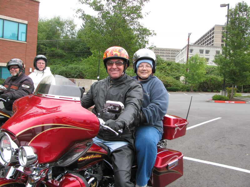 by: SUBMITTED PHOTO - Carolyn Hammett, above right, the director of Women of Wonder, prepares for takeoff on a Harley Davidson.