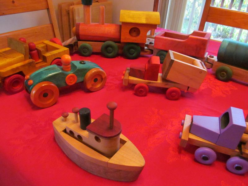 by: ELLEN SPITALERI - Pictured are a colorful log truck, trainset, race car, dumptruck and tugboat.