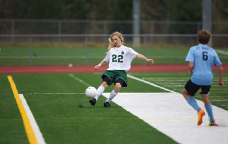 OES defender Scott DiBenedetto advances the ball