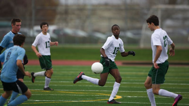 OES players (from left) Michael Brock, Yinka Laniran and Ian Brok aim to control possession.