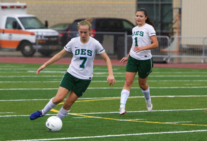 Alex Stendahl (left) takes control near midfield, with Claire Dunn in supporting position.