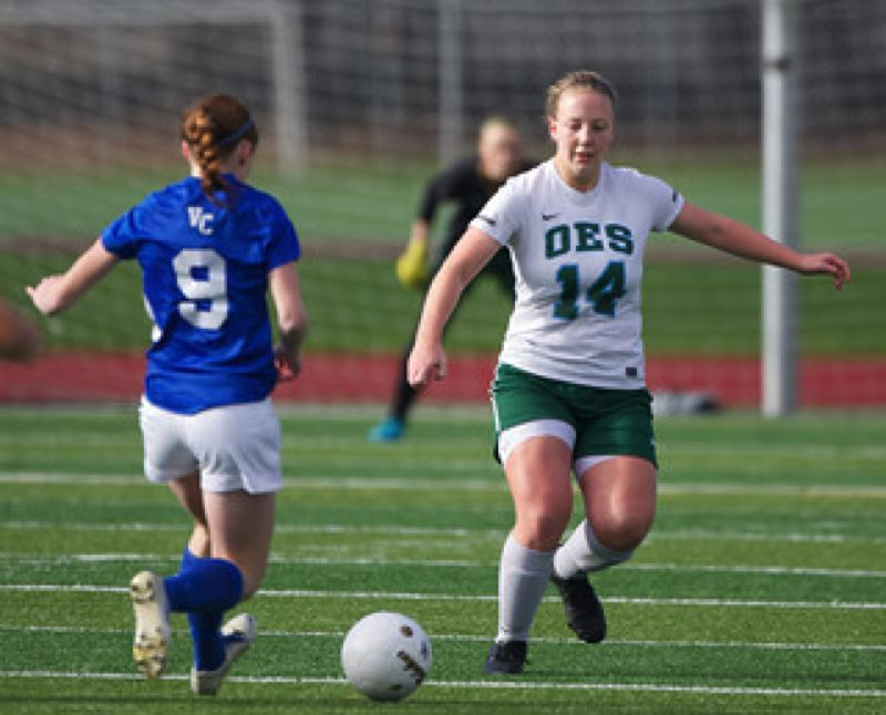 Harper Hayes (right), OES defender, closes in on Valley Catholic's Sarah Connelly.